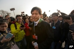 FILE -- Lei Jun, billionaire CEO and founder of Chinese electronics firm Xiaomi, arrives at the Great Hall of the People before the opening session of the National People's Congress (NPC) in Beijing.