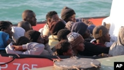Migrants picked up by a Coast Guard boat arrive at the Sicilian Porto Empedocle harbor, Italy, April 13, 2015.