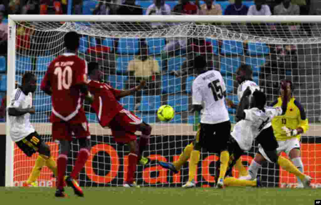 Sudan's Bashir scores against Angola during their African Nations Cup soccer match in Malabo