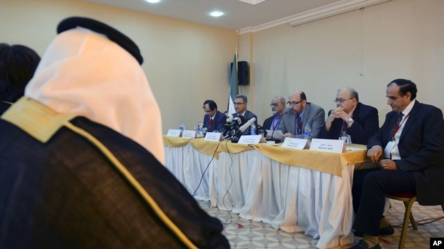 Members of Syrian opposition groups seen during a press conference after three-day meetings outside Istanbul, Turkey, October 31, 2012.