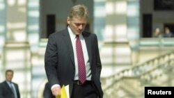 FILE - President Vladimir Putin's spokesman Dmitry Peskov is seen walking in Moscow April 17, 2014.