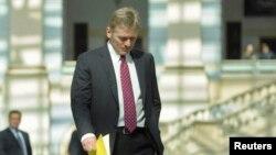 FILE - President Vladimir Putin's spokesman Dmitry Peskov is seen walking in Moscow April 17, 2014.