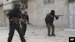 Free Syrian Army fighters train in a neighborhood of Damascus, Syria