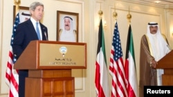 US Secretary of State John Kerry (L) and Kuwait's Deputy Prime Minister and Minister of Foreign Affairs Sheikh Sabah Khalid Hamad al-Sabah speak to the media in Kuwait City June 26, 2013.
