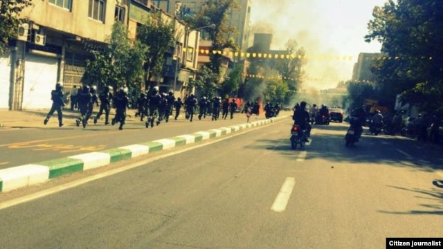 A user generated photo appears to show riot police following protesters down Saadi Street in Tehran. Via Saeed Valadbaygi on TwitPic