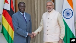 Zimbabwe's President Robert Mugabe, left, poses with Indian Prime Minister Narendra Modi, before a bilateral meeting on the sidelines of the India Africa Forum Summit, in New Delhi, India, Wednesday, Oct. 28, 2015. (AP Photo/ Manish Swarup)