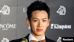 "Aktor Taiwan Kai Ko saat memenangkan penghargaan sebagai aktor terbaik untuk film ""You Are the Apple of My Eye"" dalam festival film Golden Horse di Hsinchu, Taiwan. (Foto: Dok)"