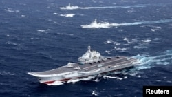 FILE - China's Liaoning aircraft carrier with accompanying fleet conducts a drill in an area of South China Sea, in this December 2016 photo.