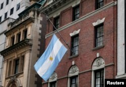 The flag hangs at half staff at the Argentine Consulate in Manhattan, recognizing the five Argentine citizens killed Tuesday in a terrorist attack in New York.