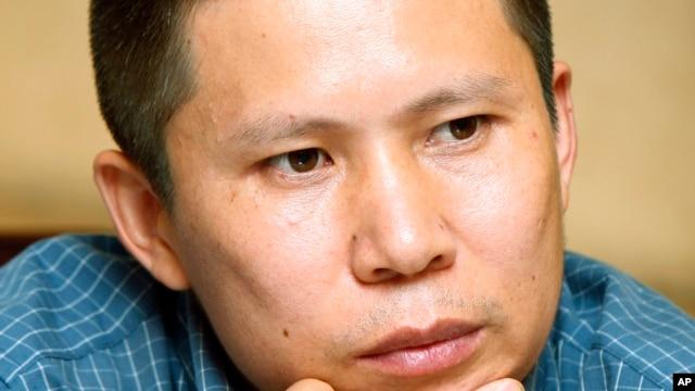 FILE - Legal scholar Xu Zhiyong at a meeting in Beijing, China.