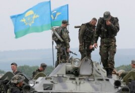 Confrontations continued Saturday between government troops and the Pro-Russian rebels. Ukrainian army paratroopers prepare to move to a position in Slovyansk, Ukraine, May 31, 2014.