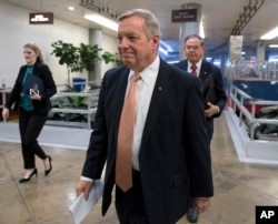 FILE - Senator Dick Durbin, D-Ill., walks to the Senate at the Capitol in Washington, Jan. 18, 2018.