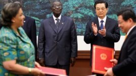 Chinese President Hu Jintao (2nd R) and Ghana's President John Atta Mills (2nd L) attend a signing ceremony after a welcoming ceremony at the Great Hall of the People, in Beijing, China, September 2010.