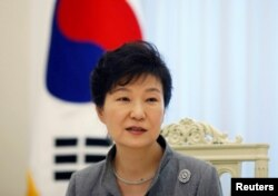FILE - South Korean President Park Geun-hye speaks during an interview at the Presidential Blue House in Seoul, Sept. 16, 2014.