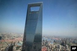 This June 25, 2009 file photo shows the Shanghai World Financial Center in Shanghai, China.