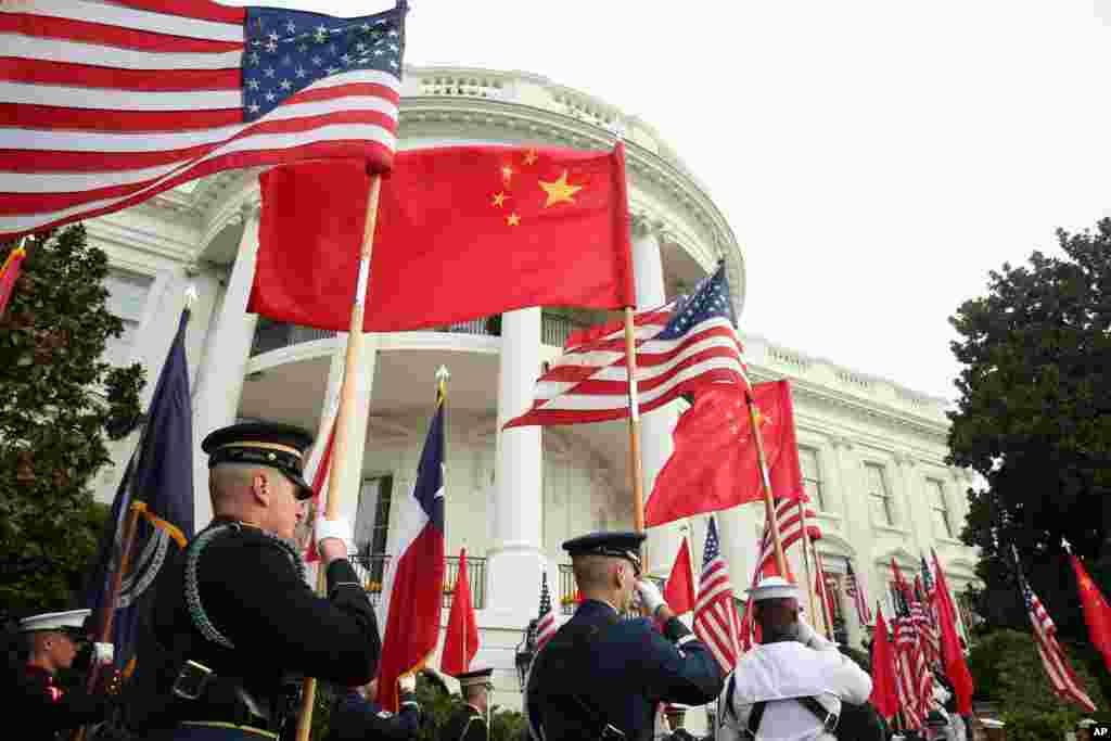A military honor guard await the arrival of President Barack Obama and Chinese President Xi Jinping for a state arrival ceremony on the South Lawn of the White House in Washington.