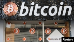 FILE PHOTO: A Bitcoin digital currency ATM shop is seen in Marseille, France, February 7, 2021. REUTERS/Eric Gaillard/File Photo