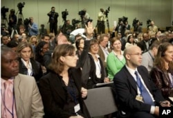 Members of the media ask questions to International Monetary Fund's Managing Director Dominique Strauss-Kahn.