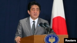 Japan's Prime Minister Shinzo Abe during a news conference in Doha, August 28, 2013 file photo.