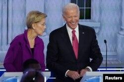 Democratic presidential candidate and Senator Elizabeth Warren talks with former Vice President Joe Biden during a break at the fifth 2020 campaign debate at the Tyler Perry Studios in Atlanta, Nov. 20, 2019.