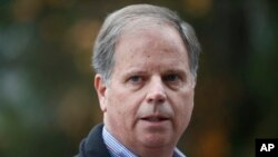 FILE - In this Dec. 4, 2017, file photo, then-Democratic senatorial candidate Doug Jones speaks at a news conference in Dolomite, Ala. Jones, the first Alabama Democrat elected to the Senate in a quarter century, is one of two new members who will take the oath of office on the Senate floor at noon on Jan. 3, 2018.
