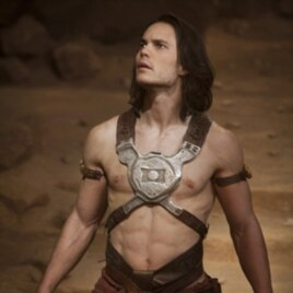 """Taylor Kitsch, as """"John Carter,"""" spends a great deal of the film wearing barely-there outfits."""