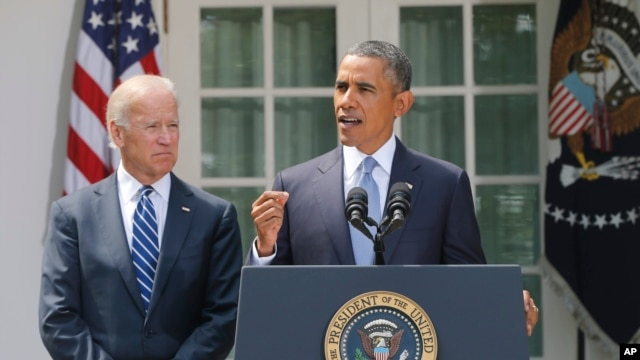 President Barack Obama stands with Vice President Joe Biden as he makes a statement about Syria in the Rose Garden at the White House in Washington, Aug. 31, 2013.
