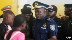 FILE - Former Kinshasa police chief, John Numbi, (C) walks into court,Jan. 27, 2011. Numbi was one of eight police officers accused of the death of a human rights activist in January 2010.