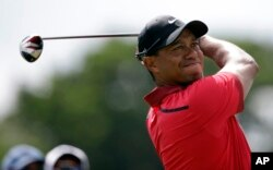 Tiger Woods hits from the third tee during the final round of the Cadillac Championship golf tournament, March 9, 2014, in Doral, Florida.