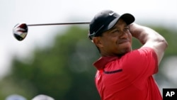 FILE - Tiger Woods hits from the third tee during the final round of the Cadillac Championship golf tournament.