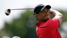 Tiger Woods hits from the third tee during the final round of the Cadillac Championship golf tournament, Mar. 9, 2014, in Doral, Florida.
