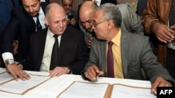 Awad Mohammed Abdul-Sadiq, the first deputy head of the Tripoli-based General National Congress, and Ibrahim Fethi Amish from the internationally recognized House of Representatives. (File)