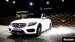The new Mercedes-Benz 2015 C-Class is displayed during a private preview for media at the Westin Book Cadillac Hotel in Detroit, Michigan, Jan. 12, 2014, on the eve of the 2014 North American International Auto Show.