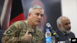 General John Campbell, left, commander of U.S. and NATO forces in Afghanistan, and Afghan acting Defense Minister Masoom Stanekzai hold a press conference at the Afghan Defense ministry in Kabul, Feb. 7, 2016.