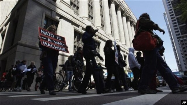 Dozens take part in a variety of protests leading up to this weekend's NATO summit in Chicago, May 16, 2012.