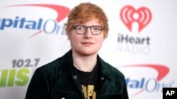 Ed Sheeran arrives at Jingle Ball at The Forum, Dec. 1, 2017, in Inglewood, California.