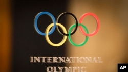 Report On Olympics Filed By Michael Kariati