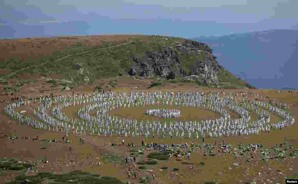 "Followers of the Universal White Brotherhood, an esoteric society that combines Christianity and Indian mysticism set up by Bulgarian Peter Deunov in the 1920s, perform a dance-like ritual called ""paneurhythmy"" in Rila Mountain, Bulgaria, Aug.19, 2019."