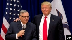 FILE - Then Republican presidential candidate Donald Trump is joined by then Maricopa County, Arizona, Sheriff Joe Arpaio at a campaign event in Marshalltown, Iowa, Jan. 26, 2016.