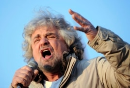 Five-Star Movement leader and comedian Beppe Grillo gestures during a rally in Turin, Italy, Feb. 16, 2013.