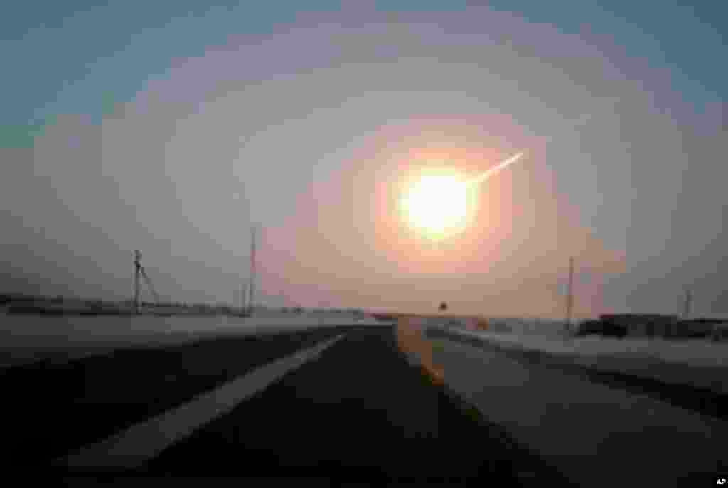 A meteorite contrail is seen in this frame grab made from a video, on a highway from Kostanai, Kazakhstan, to Chelyabinsk region, Russia, provided by Nasha Gazeta newspaper. A meteor streaked across the sky of Russia's Ural Mountains, causing sharp explosions and reportedly injuring more than 1,000 people, including many hurt by broken glass.