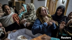 FILE - A mother mourns her son Mohammed Ali Khan, 15, a student who was killed during an attack by Taliban gunmen on the army-administered Public School, at her house in Peshawar, December 16, 2014.