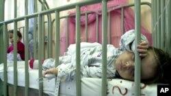 FILE - An infant infected with rotavirus sleeps at the San Rafael hospital in Santa Tecla, El Salvador, Feb. 19, 2004.