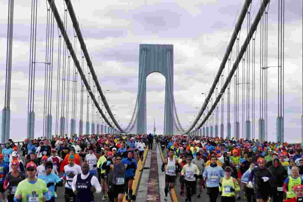 Runners cross the Verrazano-Narrows Bridge at the start of the New York City Marathon, Nov. 2, 2014, in New York.