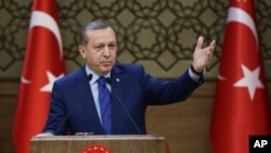 FILE - Turkish President Recep Tayyip Erdogan addresses a meeting of local administrators at his palace in Ankara, March 16, 2016. Ties between the Israel and Turkey broke down in 2010 over Israel's interception of a Turkish aid ship bound for Gaza.