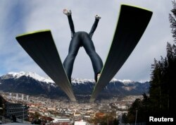 FILE - Austria's Gregor Schlierenzauer takes off from the ski jump during the first practice session of the third jumping of the four-hills tournament in Innsbruck, Jan. 3, 2014.