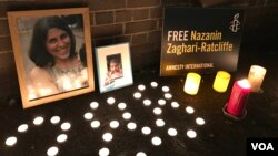 FILE - Flowers and photos at a vigil for Nazanin Zaghary-Ratcliffe, a British-Iranian woman detained in Iran, are seen in this Jan. 16, 2017 photo.