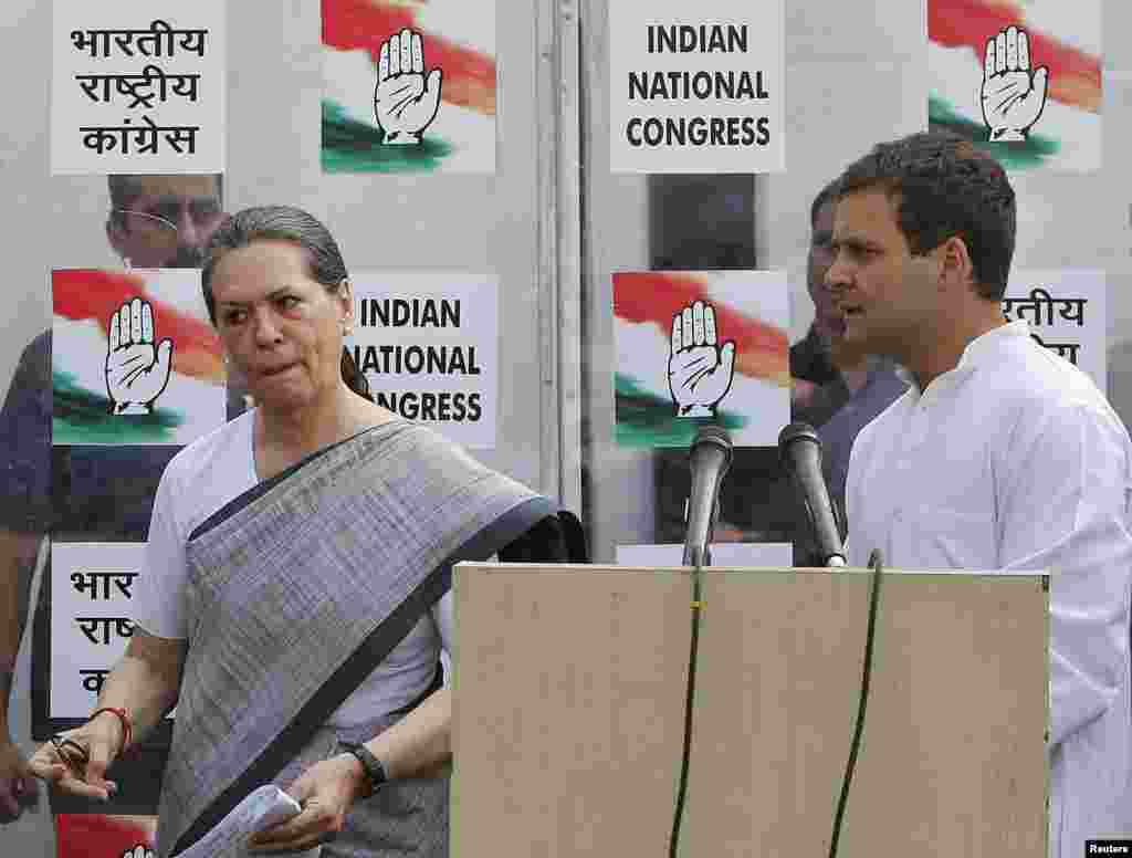 Congress party chief Sonia Gandhi and her son and vice president of Congress, Rahul Gandhi, leave after addressing a news conference.India's Nehru-Gandhi dynasty, the towering force of Indian politics for much of the last century, faces a fight for its survival, in New Delhi, May 16, 2014.