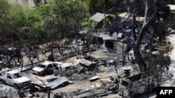 Un incendie a dévasté quelque 3 300 hectares et des véhicules à Vitrolles, dans le sud de la France, 11 août 2016.
