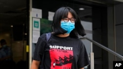 FILE - Chow Hang Tung, vice chairperson of the Hong Kong Alliance in Support of the Democratic Patriotic Movements of China, leaves a police station in Hong Kong, June 5, 2021.